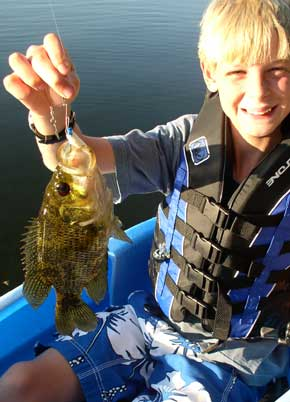 Boy with rock bass